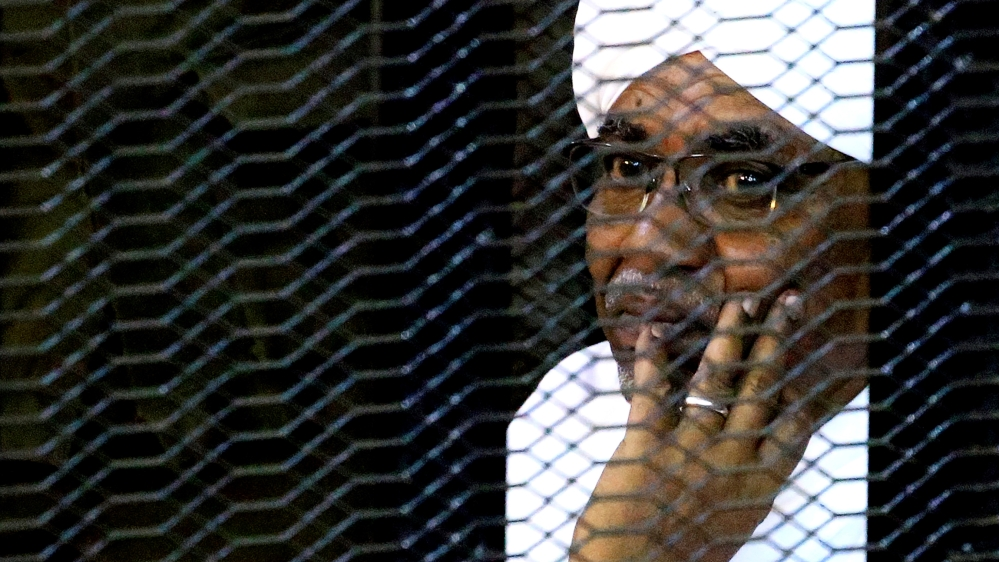 Omar al-Bashir inside a cage at the courthouse during his corruption trial in Khartoum [File: Mohamed Nureldin Abdallah/Reuters]